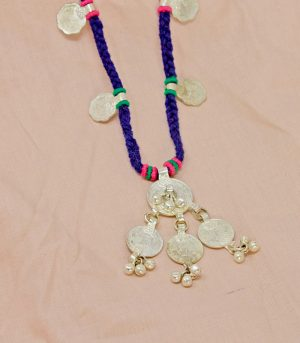 Metal ornaments with braided cotton threads